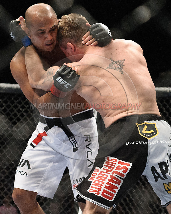 "LAS VEGAS, NEVADA, MAY 24, 2008: BJ Penn (facing) and Sean Sherk grapple during ""UFC 84: Ill Will"" inside the MGM Grand Garden Arena in Las Vegas"