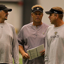 12 August 2009: Saints general manager Mickey Loomis (left) talks with defensive coordinator Gregg Williams (center) and head coach Sean Payton (right) after practice during New Orleans Saints training camp at the team's indoor practice facility in Metairie, Louisiana.