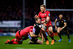 Stuart Hogg of Exeter Chiefs is challenged by Brad Barritt of Saracens - Mandatory by-line: Ryan Hiscott/JMP - 29/12/2019 - RUGBY - Sandy Park - Exeter, England - Exeter Chiefs v Saracens - Gallagher Premiership Rugby