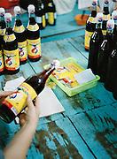 Labeling fish sauce bottles.