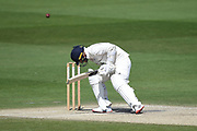 Lewis McManus of Hampshire takes a blow the the helmet off the bowling of George Garton during the Bob Willis Trophy match between Sussex County Cricket Club and Hampshire County Cricket Club at the 1st Central County Ground, Hove, United Kingdom on 3 August 2020.
