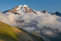 Clouds dissipating in the evening around Mount Baker (elevation 10,778 feet (3,285 m). Seen from Chowder Ridge, Mount Baker Wilderness Washington USA