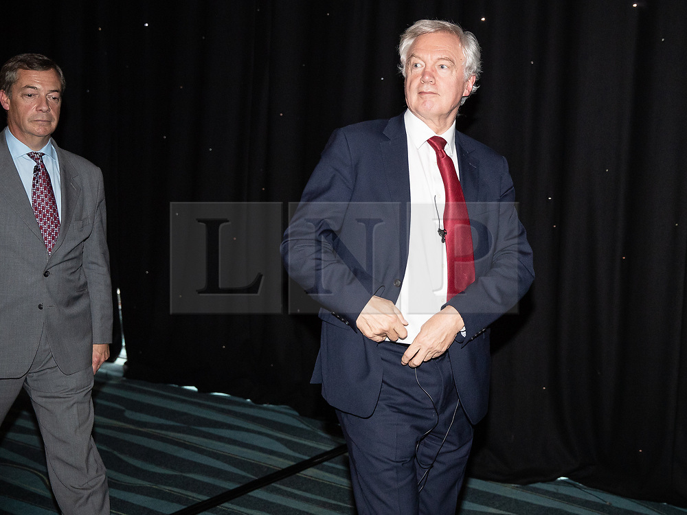 """© Licensed to London News Pictures . 22/09/2018. Bolton, UK. NIGEL FARAGE and DAVID DAVIS . Pro Brexit campaign group Leave Means Leave host a """" Save Brexit """" and """" Chuck Chequers """" rally at the University of Bolton Stadium , attended by leave-supporting politicians from a cross section of parties , including Conservative David Davis , former UKIP leader Nigel Farage and Labour's Kate Hoey . Photo credit: Joel Goodman/LNP"""