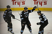 May 26, 2013; San Jose, CA, USA; San Jose Sharks center Joe Thornton (19) celebrates with center Patrick Marleau (12) and center Logan Couture (39) after scoring a goal against the Los Angeles Kings during the first period in game six of the second round of the 2013 Stanley Cup Playoffs at HP Pavilion.