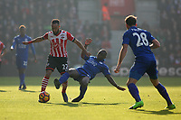 Football - 2016 / 2017 Premier League - Southampton vs. Leicester City<br /> <br /> Nampalys Mendy of Leicester City leaps in to tackle Southampton's Nathan Redmond at St Mary's Stadium Southampton England<br /> <br /> COLORSPORT/SHAUN BOGGUST
