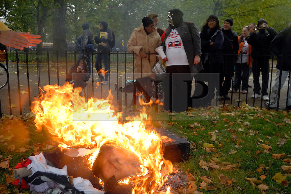 """© LONDON NEWS PICTURES 2010. 26/10/2010, Mental health service users at speakers corner, Hyde Park, London hang, draw, quarter and burn an effigy of Prime Minister David Cameron in protest at the cuts to services and benefits to come. ..""""All UK mental health sercie users will default on their medication for one day, in protest against the coming savage welfare benefits cuts. Further, all UK service users will not engage with any mental health services whatsoever on that dat, in a bid to demonstrate our power.""""©London News pictures..."""