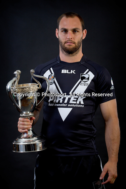 New Zealand captain Simon Mannering with the Four Nations trophy during a preview 4 Nations portrait session, in Brisbane Australia on October 24, 2014.