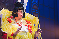"© Licensed to London News Pictures. 05/12/2013. London, England. Picture: Matthew Kelly as Widow Twankey. The Panto Aladdin starring Jo Brand as the Genie of the Ring and Matthew Kelly as Widow Twankey opens at the New Wimbledon Theatre, Wimbledon, London. From 6 December 2013 to 10 January 2014. Further actors: the dance group ""Flawless"" as the Peking Police Force, Oliver Thornton as Aladdin, David Bedella as Abanazar, Claire-Marie Hall as Princess Jasmine. Photo credit: Bettina Strenske/LNP"