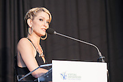 "Cat Greenleaf, host of NBC's ""Talk Stoop,"" emcees An Evening to Benefit Virtual Enterprises International held at Tribeca Three-Sixty on April 1, 2014. (Photo: JeffreyHolmes.com)"