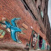 Street art graffiti wall in the West Bottoms, Kansas City Missouri, March 2011.