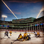 January 4, 2014, Boston, MA: <br /> Providence College and Merrimack College play each other in the first period of a game at Frozen Fenway 2014. The game ended in a 1-1 tie. <br /> (Photo by Billie Weiss/Boston Red Sox)