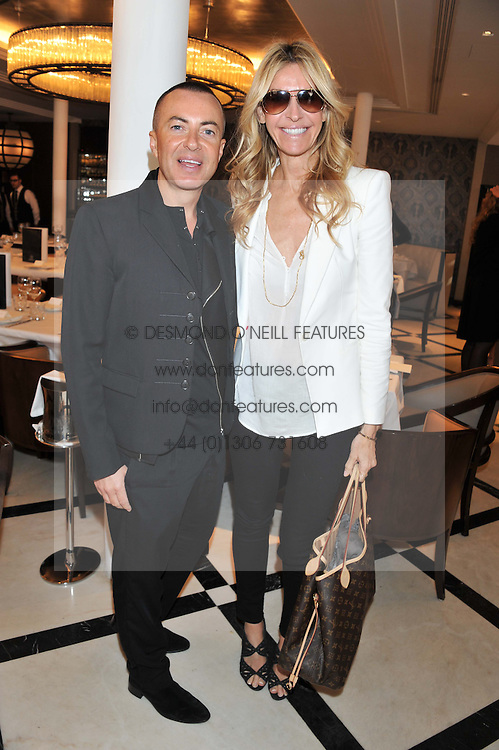 JULIEN MACDONALD and MELISSA ODABASH at a lunch to launch Cash & Rocket on Tour 2013 hosted by Julia Brangstrup in aid of Orpan Aid and Shine on Sierrra Leone held at Banca, 40 North Audley Street, London on 29th April 2013.