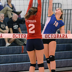 Photos by Tom Kelly IV<br /> East's Jen Matzo (18) spikes over Octorara's Julia Ditro (2) during the Downingtown East vs Octorara volleyball game at Octorara on Wednesday October 16, 2013.