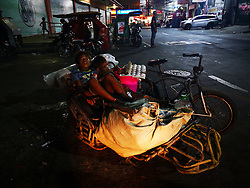 September 29, 2018 - Manila, Philippines - Due to high inflation rate and high prices of basic commodities, people in depressed areas in Manila scavenged for 'pagpag' which is a Tagalog term for leftover food from fast food restaurants and; expired frozen meat, fish, or vegetables discarded by supermarkets scavenged from garbage sites and dumps. (Credit Image: © Sherbien Dacalanio/Pacific Press via ZUMA Wire)