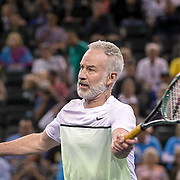 March 7, 2015, Indian Wells, California:<br /> John McEnroe hits a volley during the McEnroe Challenge for Charity presented by Masimo in Stadium 2 at the Indian Wells Tennis Garden in Indian Wells, California Saturday, March 7, 2015.<br /> (Photo by Billie Weiss/BNP Paribas Open)