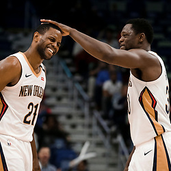 Mar 26, 2019; New Orleans, LA, USA; New Orleans Pelicans forward Darius Miller (21) reacts with center Julius Randle (30) after a score during the fourth quater against the Atlanta Hawks at the Smoothie King Center. Mandatory Credit: Derick E. Hingle-USA TODAY Sports