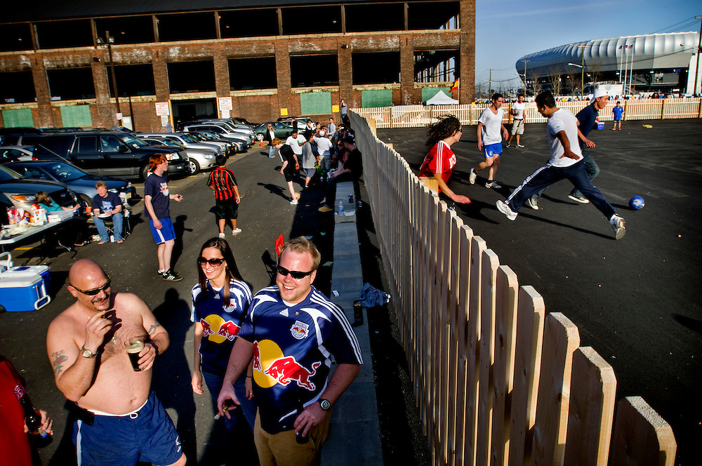 Inauguration of the Redbulls Arena in Harrison, New Jersey. .Supporters from the New Jersey Rangingbullnation smoking cigars and drinking beer in the parking lot before the game....Photographer: Chris Maluszynski /MOMENT