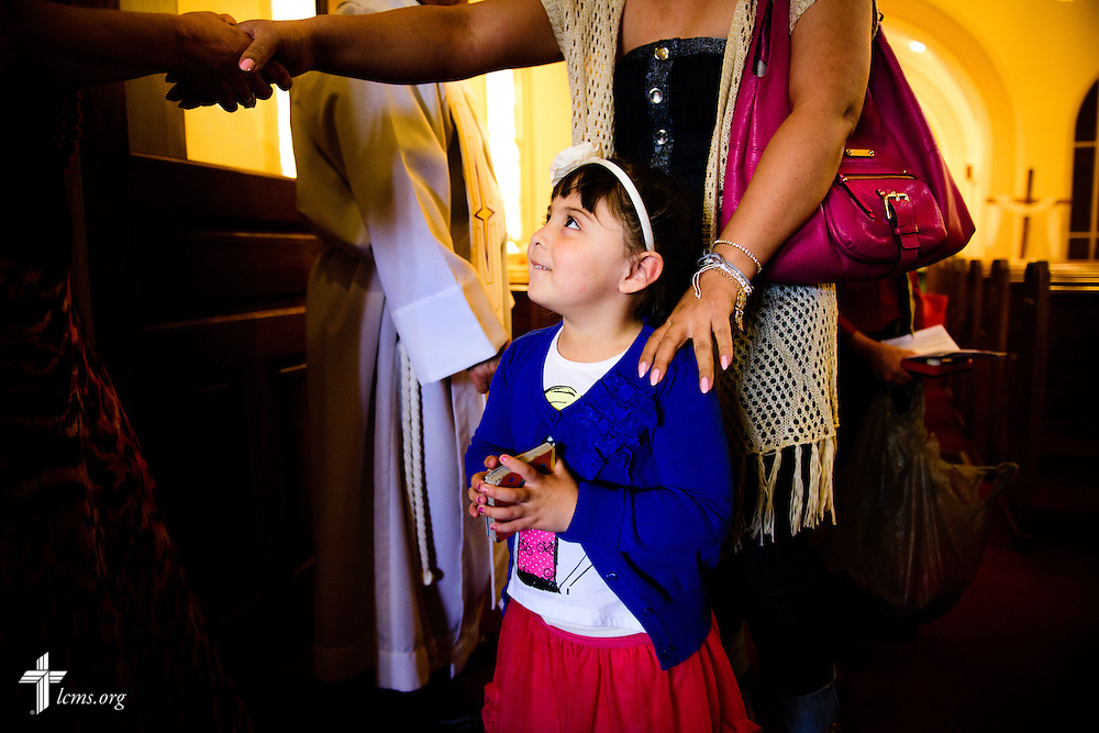 A young girl leaves following worship at La Iglesia Luterana San Pablo, the former original church building of St. Paul Evangelical Lutheran Church, on Sunday, April 10, 2016, in Columbus, Ind. LCMS Communications/Erik M. Lunsford
