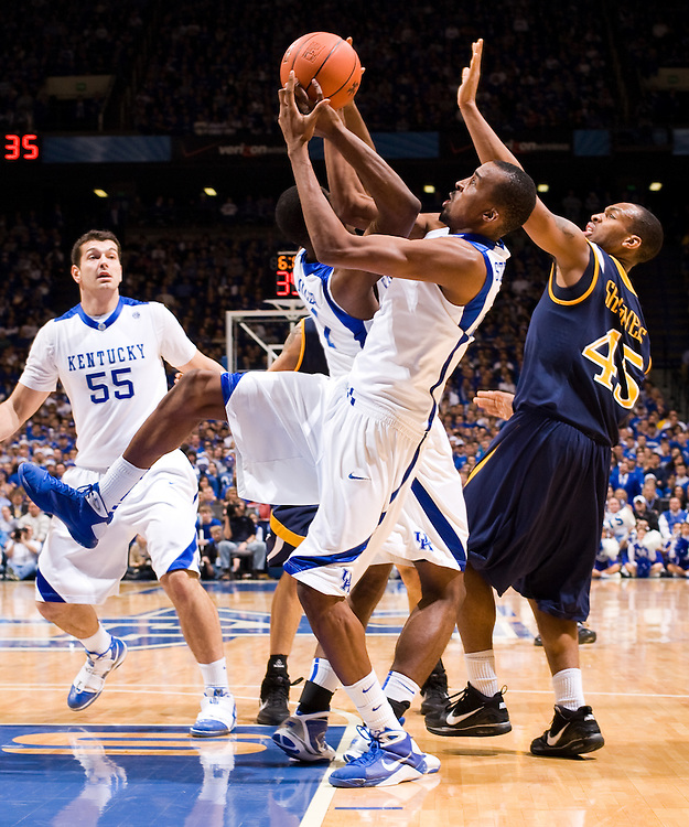 UK junior forward Josh Harrellson, left, UK sophomore guard Darius Miller, center, and UK senior forward Perry Stevenson. UK celebrated its 2,000th victory Monday, Dec. 21, 2009 at Rupp Arena in Lexington, Ky. UK defeated Drexel 88-44.  Photo by Jonathan Palmer