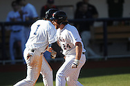 Ole Miss' Sikes Orvis (24) is congratulated by teammate Preston Overbey (1) following a three run home run vs. Georgia State at Oxford-University Stadium in Oxford, Miss. on Saturday, February 22, 2014. (AP Photo/Oxford Eagle, Bruce Newman)