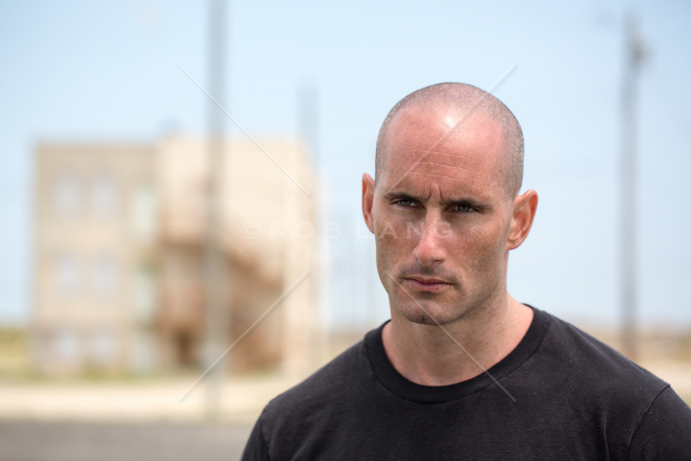 portrait of a man with a shaved head outdoors in Atlantic City, NJ