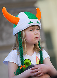 © Licensed to London News Pictures. 16/03/2014. London, UK. A young spectator enjoying the annual St Patrick's Day parade as it moves through London from Green Park to Trafalgar Square. Photo credit : David Tett/LNP