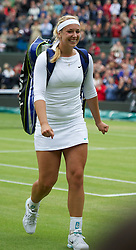 02.07.2012, Wimbledon, London, ENG, WTA Tour, The Championships Wimbledon, im Bild Sabine Lisicki (GER) walks off after winning the Ladies' Singles 4th Round match during day seven of the WTA TourWimbledon Lawn Tennis Championships at the All England Lawn Tennis and Croquet Club, London, Great Britain on 2012/07/02. EXPA Pictures © 2012, PhotoCredit: EXPA/ Propagandaphoto/ David Rawcliff..***** ATTENTION - OUT OF ENG, GBR, UK *****