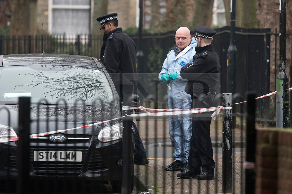 © Licensed to London News Pictures. 09/01/2018. London, UK. Police forensics at the scene in Stoke Newington where a 34 year old man has died after being assaulted. Officers arrived and found the victim suffering from stab injuries. He was taken to an east London hospital by ambulance where he died just before midnight on 8/1/2018. A murder investigation has been launched. Photo credit: Ben Cawthra/LNP