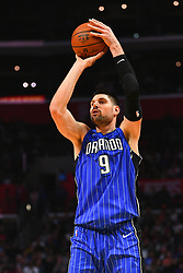 January 6, 2019 - Los Angeles, CA, U.S. - LOS ANGELES, CA - JANUARY 06: Orlando Magic Center Nikola Vucevic (9) shoots a three pointer during a NBA game between the Orlando Magic and the Los Angeles Clippers on January 6, 2019 at STAPLES Center in Los Angeles, CA. (Photo by Brian Rothmuller/Icon Sportswire) (Credit Image: © Brian Rothmuller/Icon SMI via ZUMA Press)