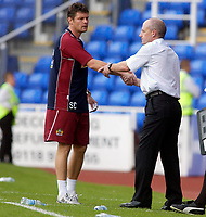 Photo: Daniel Hambury.<br /> Reading v Burnley. Coca Cola Championship.<br /> 29/08/2005.<br /> Reading's Steve Coppell and Burnley's Steve Cotterill shake hands at the end of the game.