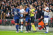 Tottenham Hotspur midfielder Erik Lamela (11) and Tottenham Hotspur forward Harry Kane (10) appeal for a free kick to referee Ivan Kruzliak during the Champions League group stage match between Tottenham Hotspur and PSV Eindhoven at Wembley Stadium, London, England on 6 November 2018.