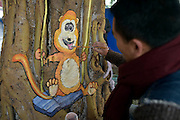 CHONGQING, CHINA - JANUARY 05: (CHINA OUT) P<br /> <br /> Art Students Paint Animals On Tree Trunks<br /> <br /> Cartoon animal drawings on the tree trunks at a pedestrian street on January 5, 2016 in Chongqing, China. Students from art school painted cartoon animal drawings on the tree trunks at Yangjiaping pedestrian street in Chongqing. <br /> ©Exclusivepix Media