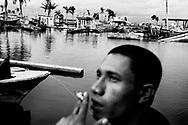 One tear after tsunami · Fisherman watching damage