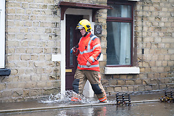 © Licensed to London News Pictures. 22/11/2016. Stalybridge UK. Picture shows the fire brigade at the scene where houses were flooded on Grove road in Stalybridge as Storm Angus hit last night. Photo credit: Andrew McCaren/LNP
