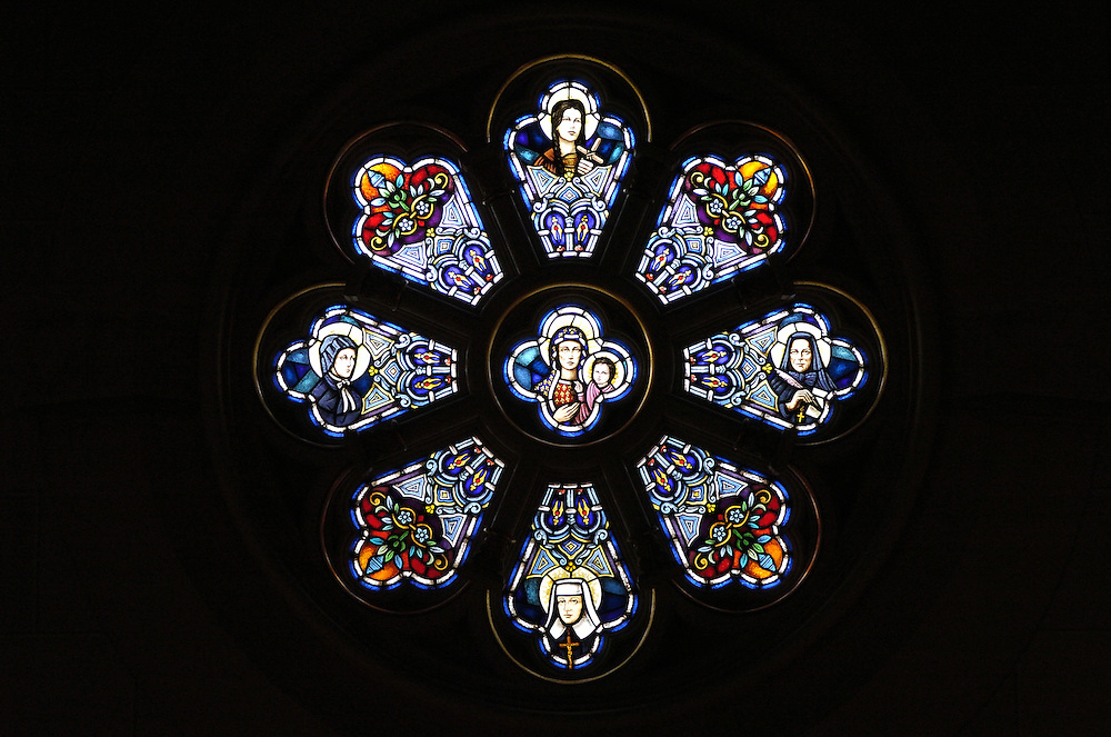 Stained glass windows above the choir loft inside the National Shrine of the Mary, Help of Christians, known as Holy Hill, in Hubertus, Wis. THe windows depict saintly women of the church. (Catholic Herald photo by Sam Lucero)