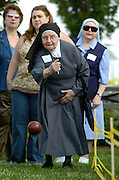 Sr. Maria Augustine Giannini, a Sister of Charity of St. Joan Antida, tosses a bocce ball during the St. Joan Antida High School reunion held July 22 at the Henry Meier Festival Grounds in Milwaukee. The girls' high school, sponsored by the Sisters of Charity, held its annual reunion at the festival grounds during Festa Italiana. The bocce tournament pits St. Joan Antida faculty and alumna against the sisters. Sr. Maria Augustine turns 90 in October. (Catholic Herald photo by Sam Lucero).