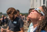 New faculty took a break from orienation and joined staff on the balcony of Baker Center to observe the solar eclipse. Photo by Ben Siegel