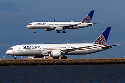 Boeing 757-224 (N29129) operated by United Airlines landing past Boeing 787-9 Dreamliner (N27957) operated by United Airlines at San Francisco International Airport (KSFO), San Francisco, California, United States of America