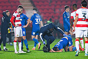 AFC Wimbledon defender Luke O'Neill (2) down injured during the The FA Cup match between Doncaster Rovers and AFC Wimbledon at the Keepmoat Stadium, Doncaster, England on 19 November 2019.