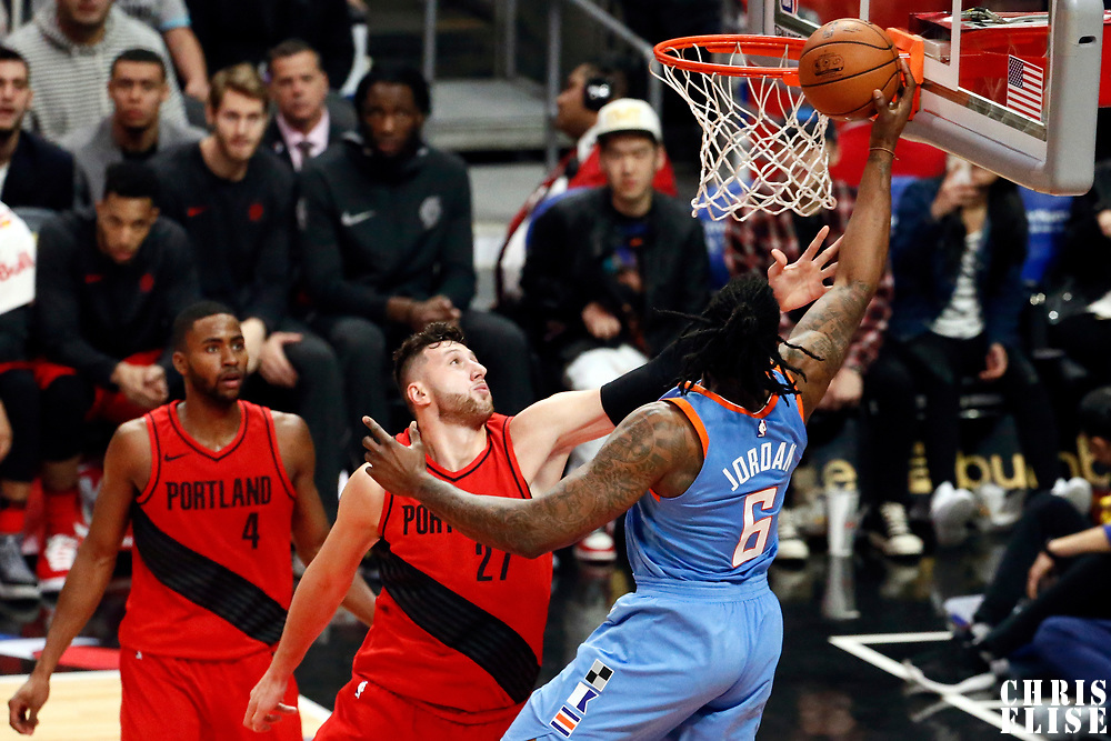 18 March 2018: LA Clippers center DeAndre Jordan (6) goes for the layup past Portland Trail Blazers center Jusuf Nurkic (27) during the Portland Trail Blazers 122109 victory over the LA Clippers, at the Staples Center, Los Angeles, California, USA.