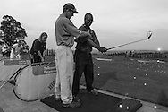 A golfer takes a lesson at the sprawling World of Golf training center in Johannesburg. Not surprisingly, many blacks are taking up the game as they rise in the corporate ranks.