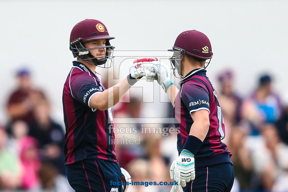 Josh Cobb of Northants Steelbacks celebrates reaching his half-century with Ben Duckett of Northants Steelbacks (right) during the Natwest T20 Blast match at the County Ground, Northampton<br /> Picture by Andy Kearns/Focus Images Ltd 0781 864 4264<br /> 26/06/2016