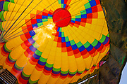 Looking up into a hot air balloon as it prepares to fly over Vang Vieng, Laos, early in the morning.