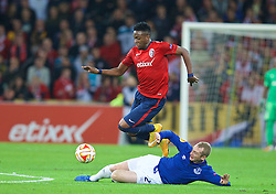 LILLE, FRANCE - Thursday, October 23, 2014: Everton's Tony Hibbert in action against Lille OSC's Divock Origi during the UEFA Europa League Group H match at Stade Pierre-Mauroy. (Pic by David Rawcliffe/Propaganda)