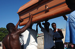 Men sing creole hymns and carry the casket of Kele Tintin, who was caught in the middle of gang warfare on her way to work.  Tintin stayed alive long enough to give birth to a son the same day, and died 6 hours later.    The security situation in Cite-Soleil, one of the most dangerous slums in Haiti,  has deteriorated over the past few months with two warring gangs controlling the entire town.  In Project, the side of town controlled by a pro-aristide gang, the market had to move away from the border zone, people take creaky, wooden boats across the harbor instead of crossing the dividing line, and children are threatened with death if they attempt to cross the line on their way to school.