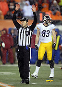 NFL umpire Mark Pellis (131) raises his arms as he signals touchdown during the Cincinnati Bengals NFL AFC Wild Card playoff football game against the Pittsburgh Steelers on Saturday, Jan. 9, 2016 in Cincinnati. The Steelers won the game 18-16. (©Paul Anthony Spinelli)