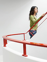 Young woman walking up stairs indoors