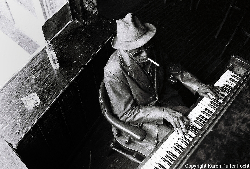 Bluesman Mose Vison plays some boogie woogie piano on Beale Street before his death.