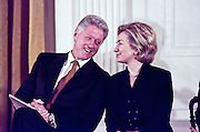 US President Bill Clinton and First Lady Hillary Clinton laugh after Senator Chuck Robb, jokes about Mrs. Clinton's speculated run for the US Senate seat in New York, soon to be vacated February 17, 1999 at the White House in Washington, DC. This took place at a Social Security event in the East Room of the White House.