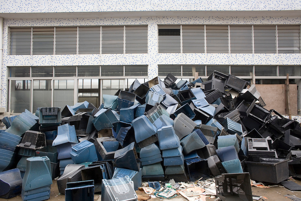 A pile of discarded computer parts awaits processing in a workshop in Panyu, China. Each year, between 20 and 50 million tons of electronic waste is generated globally. Most of it winds up in the developing world. Some of the most popular destinations for dumping computer hardware include China, India, and Nigeria. It can be 10 times cheaper for a ìrecyclerî to ship waste to China than to dispose of it properly at home. With the market for e-waste expected to top $11 billion by 2009, itís lucrative to dump on the developing world.